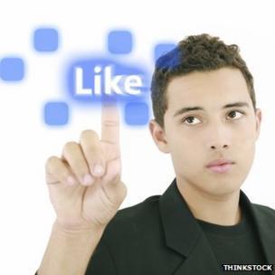 "Man pressing ""Like"" button"