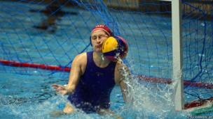 Italy's goalkeeper Giulia Gorlero saves the ball with her face