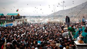 Afghans gather near a shrine to celebrate Nowruz in Kabul