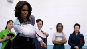 US First Lady Michelle Obama plays table tennis