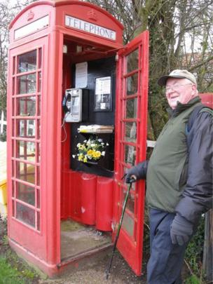 Murray stands by a red phone box