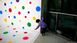 A child tries to touch part of the art exhibition A Dream I Dreamed