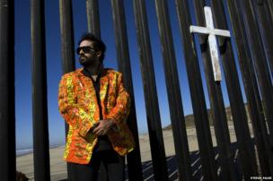 Artist Pablo Llana at the border fence in Playas de Tijuana