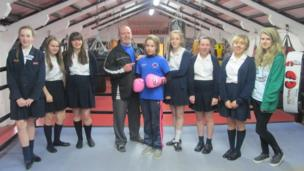 Weatherhead High School pictured with Year 9 national champion boxer and her trainer.