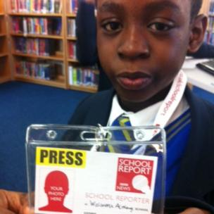 Simon from Walworth Academy holds up his BBC School Reporter press pass.