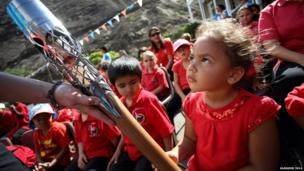 A Pilling Primary School student holds the Queen's baton in Jamestown, St. Helena.