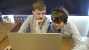 Uckfield Community Technology College Reporters Ethan and Harry check sound levels for filming