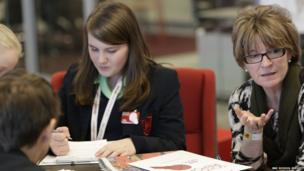 Student from Guildford County School writing up her latest events
