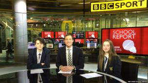 Henry and Niamh from Poynton High School sit with BBC Sport presenter John Watson
