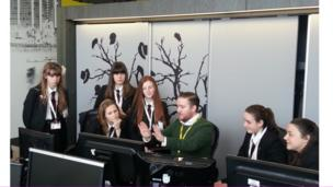 Pupils from Cardinal Langley RC High School in Middleton are guided by BBC Sport's Simon Needle