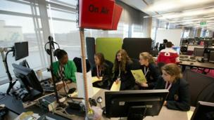 Students from Malbank School and Sixth Form College with weather presenter Eno Eruoto.