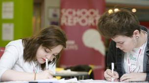 Two School Reporters writing