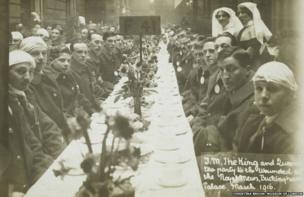 Tea party for wounded soldiers and sailors at the Royal Mews