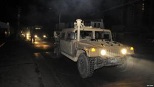 A military convoy travels along a road after a tsunami alarm at Iquique city, north of Santiago on the southern Pacific coast, April 1
