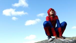 """A boy poses as """"Superhero For The Planet"""" Cape Town, South Africa, on 29 March 2014"""
