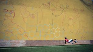 Kenyan plays with a ball in Rio de Janeiro, Brazil, on 1 April 2014