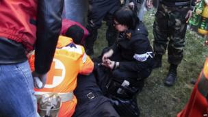 A wounded policeman receives medical assistance following clashes with pro-Russian activists who stormed the regional security service building in Luhansk on 6 April 2014