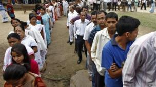 Voters line up to cast their vote outside a polling station in Nakhrai village in Tinsukia district, in the northeastern Indian state of Assam April 7, 2014.