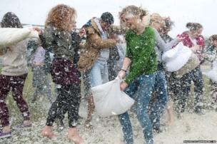 People meet for the International Pillow Fight Day in the Westpark in Berlin, Germany