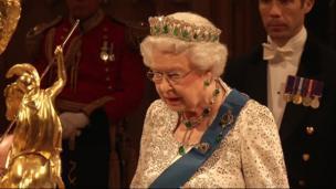 Queen Elizabeth II speaking at a formal banquet.