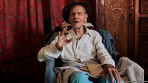 Hector Gaitan, 110, sits inside his home, at an abandoned station of the Nicaraguan Railway Company