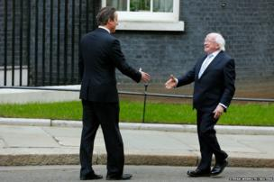 Britain's Prime Minister David Cameron (left) greets Ireland's President Michael D. Higgins as he arrives at Number 10 Downing Street in London