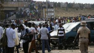 People gather after a bomb explosion at a bus terminal in Nyanyan, Abuja on 14 April 2014.