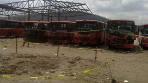 Damaged buses following blast at bus station outside Abuja on 14 April 2014.