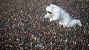 The giant inflated astronaut, Escape Velocity at the Coachella Valley Music and Arts Festival