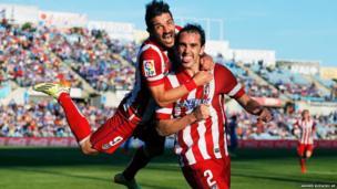 Atletico's Diego Godin celebrates his goal with teammate David Villa