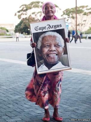 Woman holding poster of Nelson Mandela