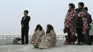 Relatives wait for their missing loved ones at a port in Jindo, South Korea - 16 April 2014