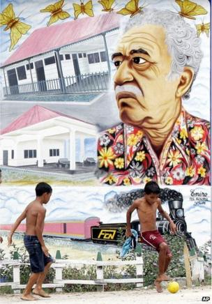 Two boys play soccer in front a mural painting of Nobel Prize-winner Gabriel Garcia Marquez in Aracataca, Colombia, Jan. 4, 2006.