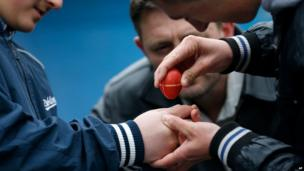 People take part in an egg-cracking contest in the village of Mokrin, 120km (75 miles) north of Belgrade, Serbia on 20 April 2014