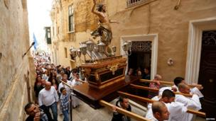 Worshippers carry a statue of Christ through the streets of Cospicua, outside Valleta in Malta on 20 April 2014