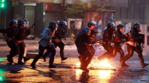 Member of the national police confront demonstrators during a protest against the government of Venezuelan President Nicolas Maduro