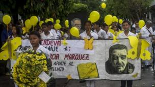 Students participate in a symbolic funeral in Aracataca, Colombia, April 21, 2014.