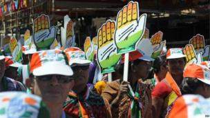 Supporters of Indian Congress party candidate Milind Deora carry cutouts of the Congress party symbol - the hand - during a roadshow in Mumbai