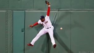 Jackie Bradley of the Boston Red Sox jumps to catch the ball