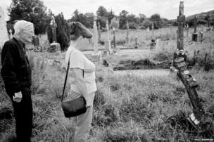 Father and daughter at grandparents' grave