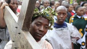 A man carries a crucifix in Nairobi, Kenya - Friday 18 April 2014