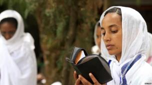 An Orthodox Christian reads her Bible, Addis Ababa, Ethiopia - Friday 18 April 2014