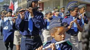 Girls and women playing flutes on an inter-faith march to parliament, Cape Town, South Africa - Saturday 19 April 2014