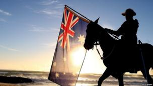 A member of the Mudgeeraba light horse troop takes part in the ANZAC dawn service at Currumbin Surf Life Saving Club on 25 April, 2014 in Gold Coast, Australia