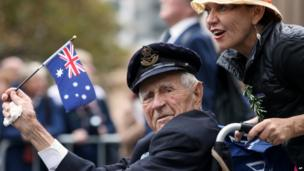 A veteran is pushed in a wheelchair during the ANZAC Day parade, in Sydney, on Friday, 25 April, 2014