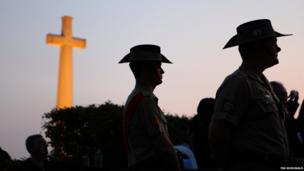 Soldiers take part in a dawn ceremony marking Anzac Day at the Kranji War Memorial in Singapore on Friday, 25 April, 2014