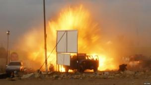 An explosion is seen during a car bomb attack at a Shia political organisation's rally in Baghdad, on 25 April 2014.