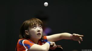 South Korea's Seo Hyowon eyes the ball as she serves to Li Jiao of the Netherlands during the World Team Table Tennis Championships in Tokyo - 28 April 2014.