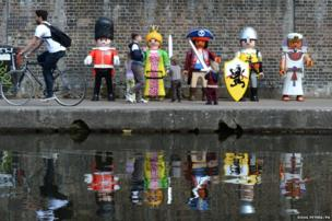 Giant Playmobil characters line Camden Lock