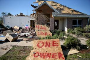 A damaged home in Louisville, Mississippi